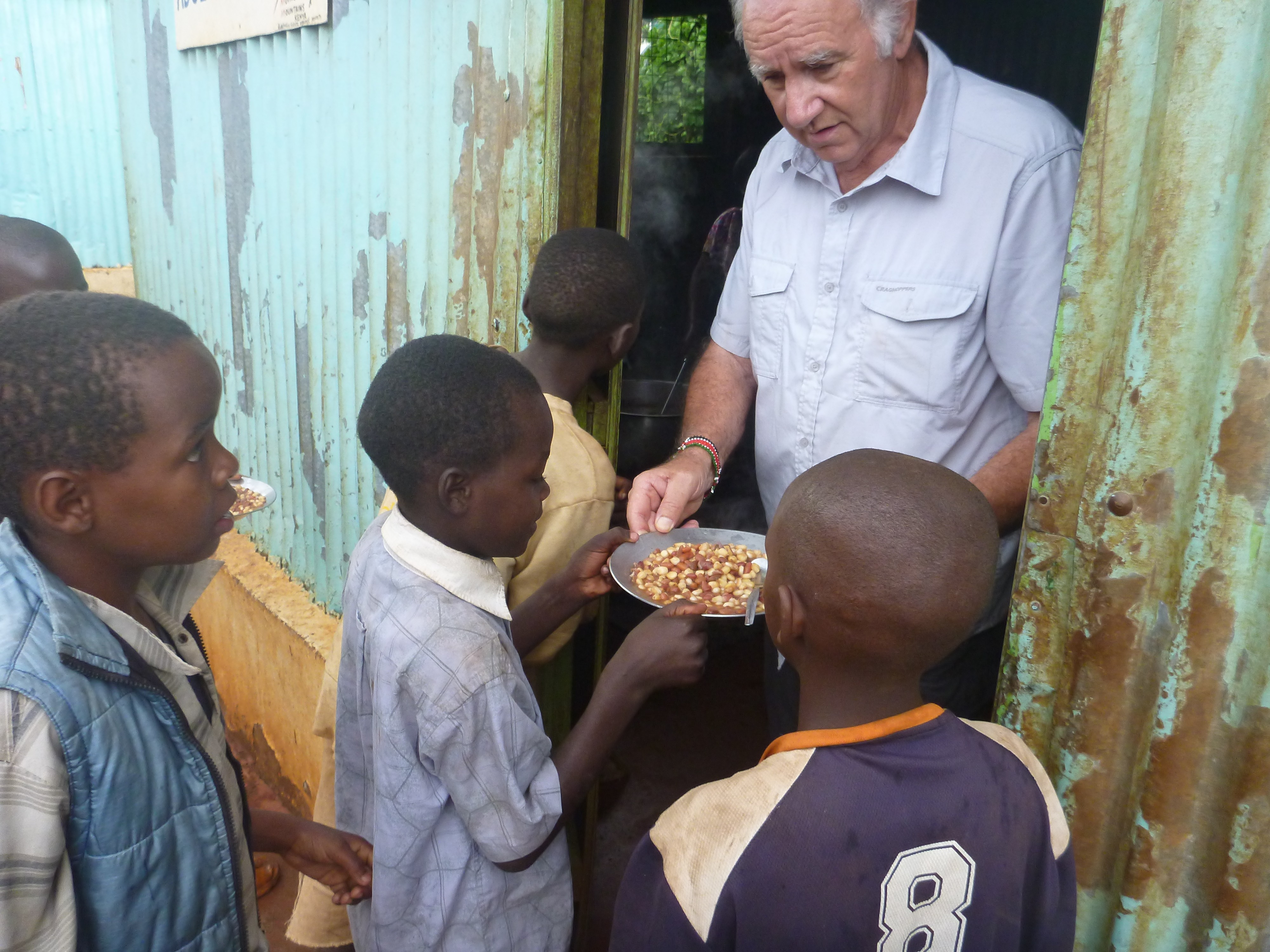 Roger handing out meals to the many Street Children